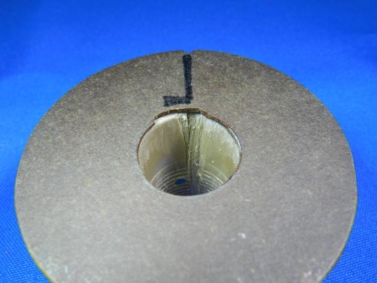 Figura 4 – Peça deslizante, vista pelo lado que faceia o enrolamento.