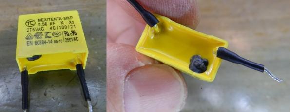 Figura 8 – Detalhes do capacitor da figura anterior, onde é possível perceber um vazamento do conteúdo interno, provavelmente resultante de um furo, por onde brotou a mistura de alumínio e polímero.