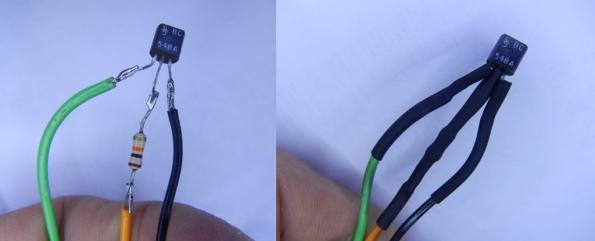 """Fig. 15 - Montagem """"aérea"""" do circuito inversor para comandar a fonte ATX. Observe que não montei o resistor R2, de 100 ohm. À direita, o isolamento feito com espaguete termorretrátil (um isqueiro passado rapidamente comprime os tubinhos)."""